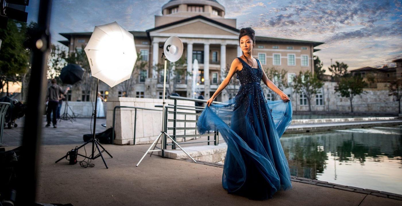 Fashion photographer shooting beautiful model