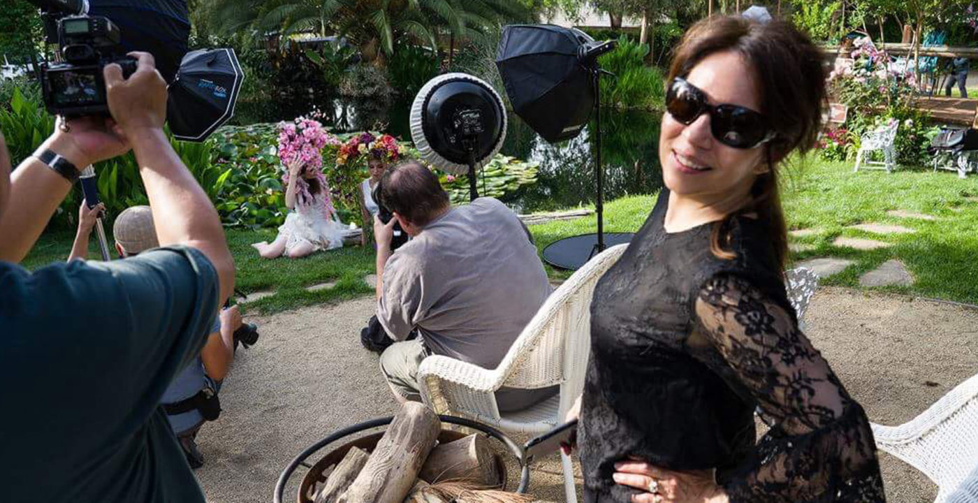 Susie Lauri, hair and makeup artist, on set.